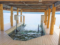 Our boat lifts are adaptable to boathouses for use with permanent docks