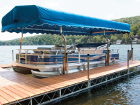 Custom canopy uprights that attaches to the dock system to create a covered boat slip with a standard canopy