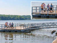 Commercial ADA fishing dock with slots in railings for fishing rods