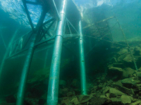 Underwater view of pile dock with underwater bracing