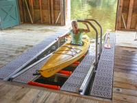 Launch system built into a boathouse slip