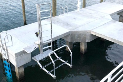 KLL-100 Kayak Ladder Lift & Launch mounted on a concrete dock with transition step