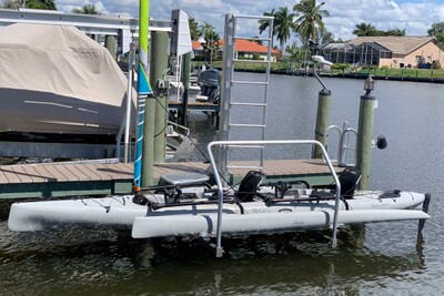 Our Kayak Lift provides a safe and easy way to launch a Hobie Tandem Island from your dock or seawall