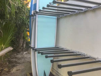 Custom vertical rack with additional support arms for multiple paddleboard storage