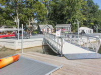 Gangway designed for golf cart access to bring guests to tour boat at a summer resort