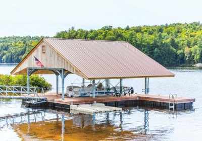 Boathouse on floating dock foundation