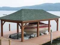 Boathouse with a hip roof built on a permanent pile dock