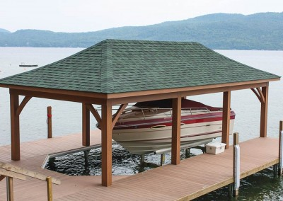 Boathouse supported by permanent pile dock