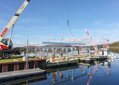 Boathouse being assembled on a floating foundation on site