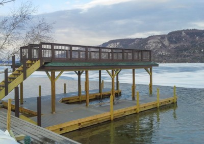 Boathouse and sundeck on crib dock foundation