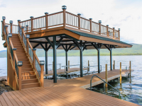 Pile dock with steel frame sundeck style boathouse & composite rails