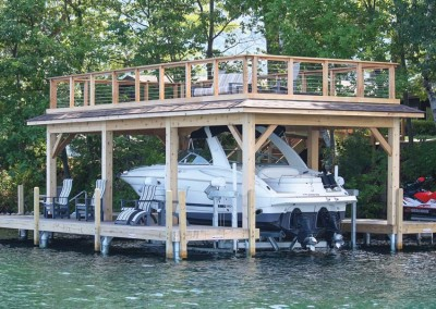 Boathouse, U-shaped pile dock, and Ultimate Boat Lift