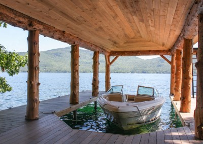 Rustic log style boathouse with rough cut material for interior ceiling
