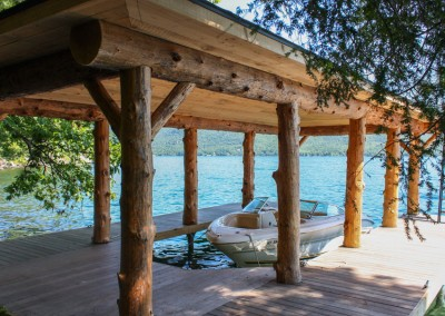 Rustic log style boathouse with our permanent pile dock as a foundation