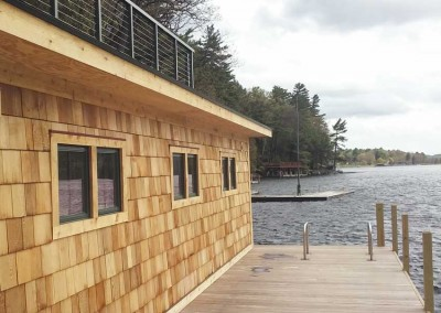 Our permanent pile dock serves as the foundation for this boathouse on Lake George, NY