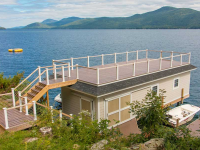 Sundeck style boathouse with stainless steel cable rails for an unobstructed view