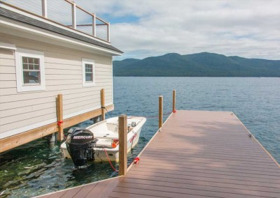 Our permanent pile dock serves as the foundation for this boathouse