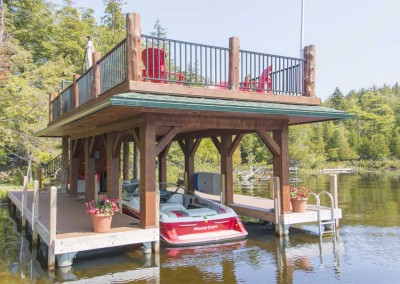 Permanent pile dock with sundeck style boathouse (boathouse by Jeffrey Beamish Construction, Upper Saranac Lake)