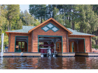 Custom floating boathouse foundation for fluctuating water levels