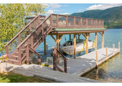 Crib dock with sundeck style boathouse and sling style boathouse boat lift