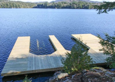 Double slip industrial pile dock with 12 inch diameter piles designed to support future boathouse