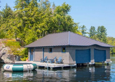Completed boathouse on our double slip industrial pile dock (boathouse by others)