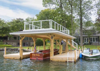 Crib dock with sundeck style boathouse