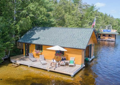 Boathouse with pile dock foundation - Upper Saranac Lake NY