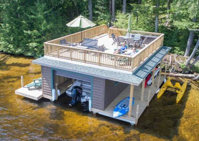 Sundeck style boathouse with pile dock foundation - Upper Saranac Lake NY