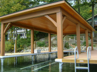 Hip style open boathouse installed on our permanent pile dock