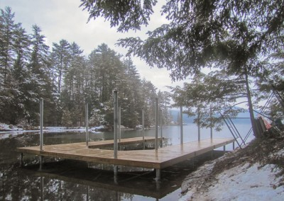 Boathouse during construction with our permanent pile dock as a foundation