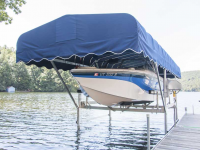 4,500 lb. vertical boat lift with Sunbrella canopy in pacific blue