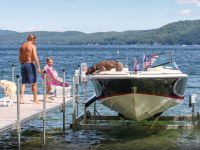 Adding a boat lift to your dock system will protect your boat and dock from damage.