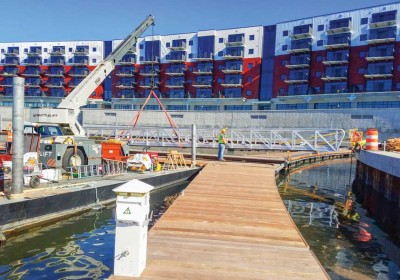 Our sectional barge and crane installing a 80' aluminum gangway at The Mohawk Harbor, Schenectady, NY