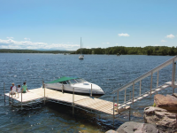 Heavy Duty steel truss leg dock with our aluminum stairs to transition over a rocky shoreline