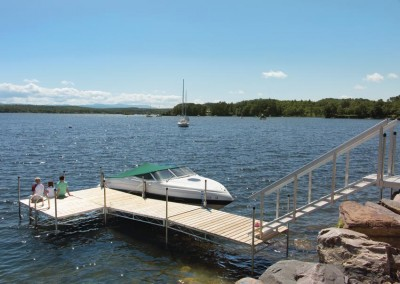 Steel truss leg docks and our aluminum stairs to transition over a rocky shoreline