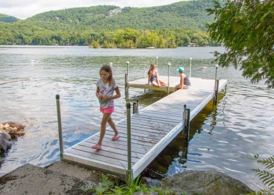 Medium duty aluminum docks with cedar decking and solar post lites
