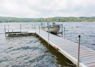 Medium duty aluminum leg docks with cedar decking and 2,000 lb. vertical boat lift