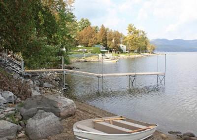 Steel truss leg docks for transitioning over a rocky shoreline