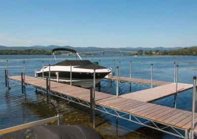 Steel truss leg docks and vertical boat lift