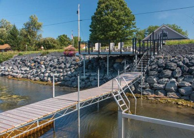 Steel truss leg docks used to transition over a rocky shoreline