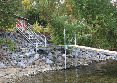 Steel truss leg docks used to transition over a rocky shoreline (also shown our aluminum stairs)