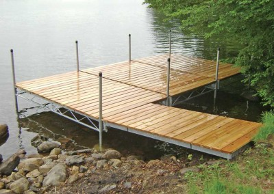 Steel truss leg docks side by side