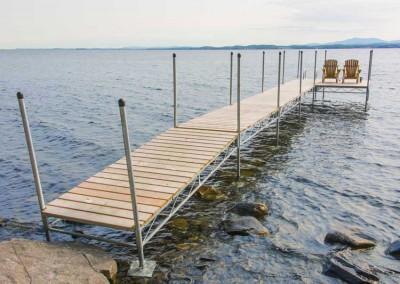 Our heavy duty steel truss leg docks with cedar decking
