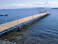 Our heavy-duty steel truss wheel docks with cedar decking