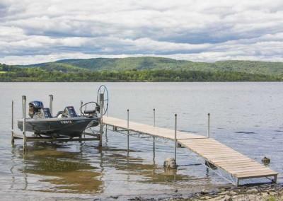 Steel truss wheel docks with cedar decking and 4,500 lb. vertical boat lift