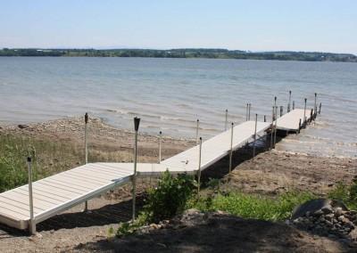 Aluminum frame floating docks connected to our aluminum leg docks to transition over shoreline
