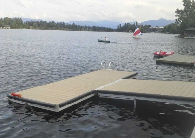 T-shaped medium duty floating dock with adjustable float frame on ramp for pitch adjustment pending water level