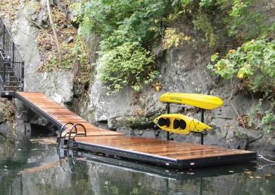 Aluminum floating dock with powder coated frame and kayak storage rack