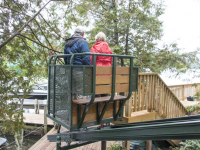 Hillside trolley serves as an alternative to stairs on a steep site on Lake George NY